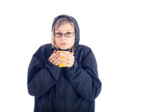 Woman in winter jacket holding mug with hot drink. Royalty Free Stock Photo