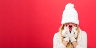 Woman with winter knit hat pulled over her eyes Stock Photos