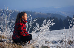 Woman and a winter landscape. Woman in the checkered coat winter landscape mountain forest Royalty Free Stock Photography