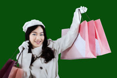 Woman in winter mantle holds shopping bags Royalty Free Stock Photography