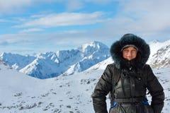 Woman on winter mountain background (Austria). Stock Photography