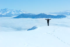 Woman on winter mountain top Royalty Free Stock Image