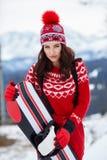 Woman winter outdoor snowboarding stock photo