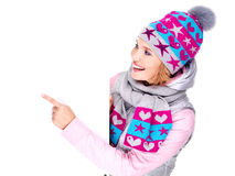 Woman in winter outerwear  holds the banner and points on it Stock Photography