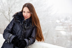A woman is in the winter park Stock Images