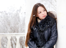A woman is in the winter park Royalty Free Stock Photo