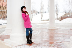 Woman is in winter in a park Royalty Free Stock Image