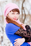 Woman is in winter in a park Stock Photos