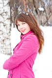 Woman is in winter in a park Stock Images