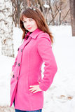 Woman is in winter in a park Stock Photo