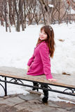 Woman is in winter in a park Royalty Free Stock Images