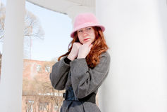 Woman is in winter in a park Royalty Free Stock Photography