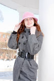 Woman is in winter in a park Stock Image