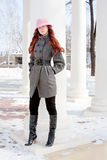 Woman is in winter in a park Royalty Free Stock Photos