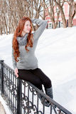 Woman is in winter in a park Royalty Free Stock Photo