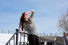 Woman is in winter in a park Stock Photography