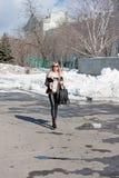 Woman in a winter park Stock Photos