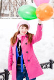 Woman in a winter park  with air marbles Royalty Free Stock Photo