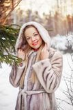Woman in winter park Royalty Free Stock Image