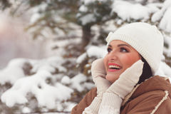 Woman in winter park closing face with mittens Royalty Free Stock Photography