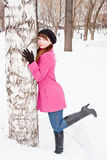 Woman in a winter park near a birch Stock Image