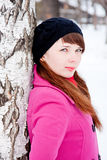 Woman in a winter park near a birch Stock Photo