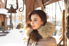 Woman in winter park. Near some buildings Stock Photography