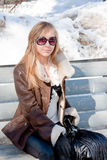 Woman in a winter park sits on a bench Stock Photography