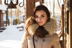 Woman in winter park. Near some buildings Royalty Free Stock Photos