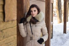 Woman in winter park. Near some buildings Royalty Free Stock Photography