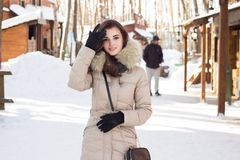 Woman in winter park. Near some buildings Royalty Free Stock Images