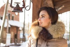 Woman in winter park. Near some buildings Royalty Free Stock Image