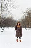 Woman in winter park Stock Images