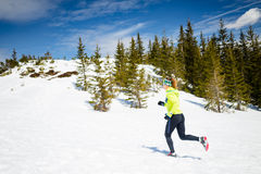Woman winter running in beautiful inspirational landscape Royalty Free Stock Photos