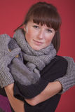 Woman in winter scarf and gloves Stock Photos