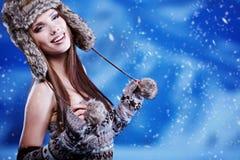 Woman in winter scenery Stock Photos
