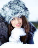 Woman in the winter scenery Stock Image