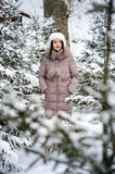 Woman in winter scenery in forest Royalty Free Stock Image