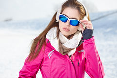 Woman in winter scenery Royalty Free Stock Images