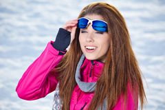 Woman in winter scenery Stock Images