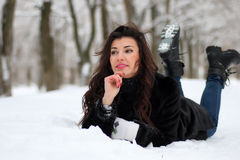 Woman in winter snow-covered park Royalty Free Stock Photos