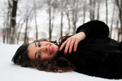 Woman in winter snow-covered park Royalty Free Stock Images