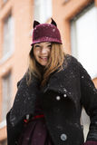 Woman at winter street with funny hat Stock Images