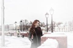 Woman on winter street stock photo