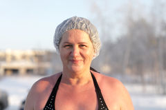 Woman after winter swimming Royalty Free Stock Images