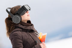 Woman in winter with virtual reality glasses Royalty Free Stock Images