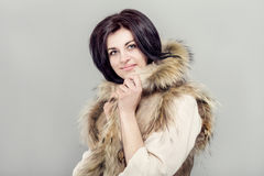 Woman with winter waistcoat. Royalty Free Stock Photo
