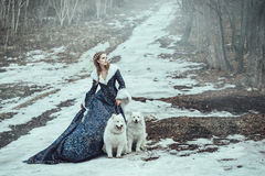 The woman on winter walk with a dog Royalty Free Stock Photos
