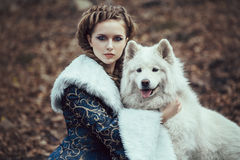The woman on winter walk with a dog Royalty Free Stock Image