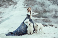 The woman on winter walk with a dog Royalty Free Stock Photography